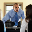Man shouting in front of 2 female colleagues