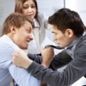 Men physically fighting in the office