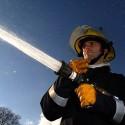 Fire Fighter spraying hose